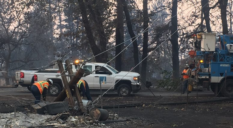 PG&E crews carry out repair work in Paradise, CA