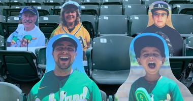 Cardboard cutouts replace A's fans at The Coliseum because of coronavirus restrictions at games this season.