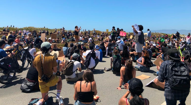 Protests against the police murder of George Floyd march along Ocean Beach, San Francisco, June 2, 2020