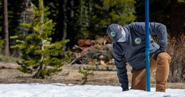 Sean de Guzman, chief of California Department of Water Resources (DWR), Snow Surveys and Water Supply Forecasting Section, conducts the final snow survey of the 2020 season at Phillips Station in the Sierra Nevada Mountains.