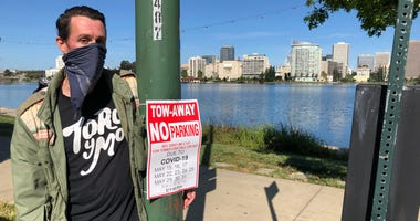 Lakegoers will see more signs warning of possible fines if they violate distancing orders at Lake Merritt.