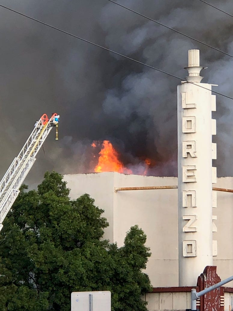 Firefighters battle a fire at the Old San Lorenzo Theater.