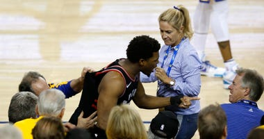 shirt) after Lowry chased down a loose ball in the second half against the Golden State Warriors during Game Three of the 2019 NBA Finals at ORACLE Arena on June 05, 2019 in Oakland, California.