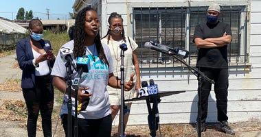 """The """"Better Neighborhoods, Same Neighbors"""" grant is announced in Oakland."""