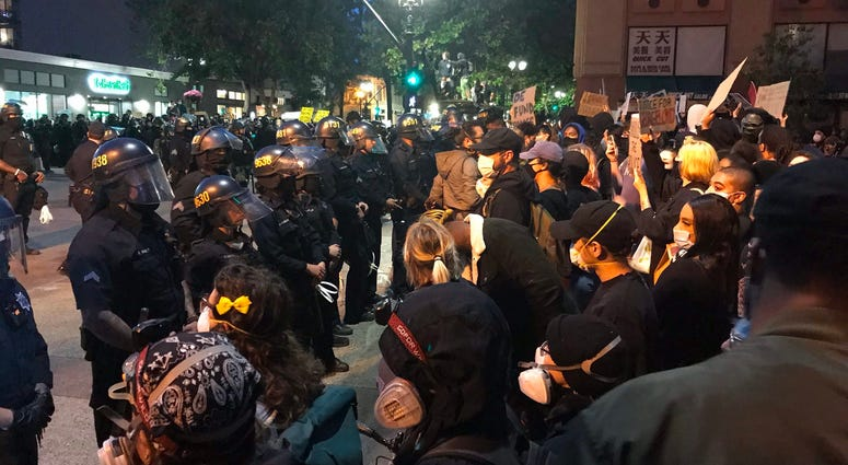 Protesters clash with police in Oakland.