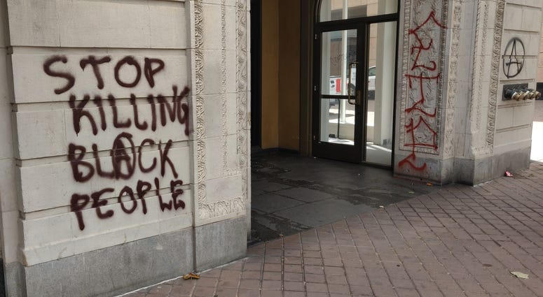 Graffiti seen in downtown Oakland following Friday's protest.