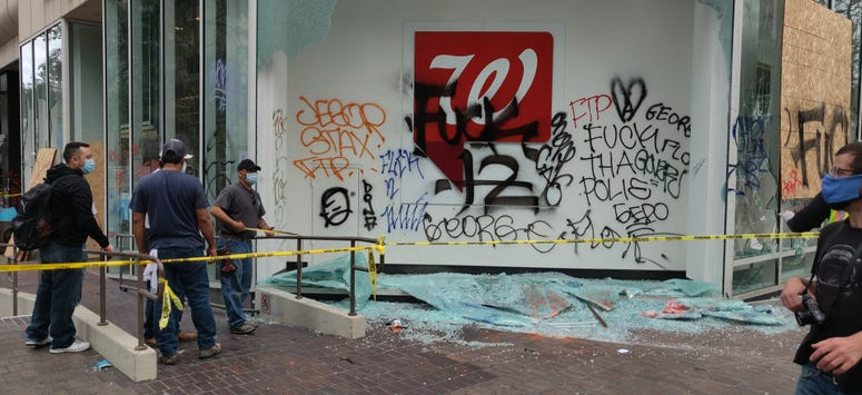 Offensive language spray painted on the side of a looted Walgreens in Oakland.