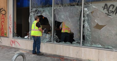 Smashed windows at a business in downtown Oakland.