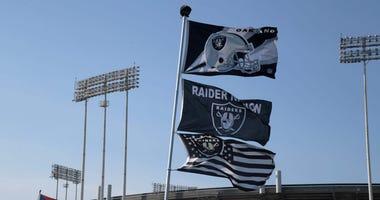 Flags wave outside of Oakland Alameda County Coliseum.