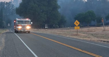 A fire rig speeds down a road as crews battle the Quail Fire in Solano County.