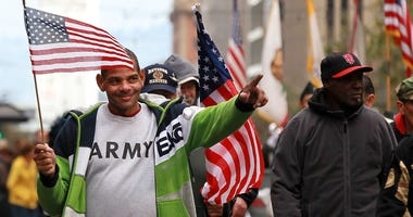 A U.S. Army veteran acknowledges the crowd during the 92nd Annual San Francisco Veterans Day Parade on November 11, 2011. This Sunday's parade will begin at 11am from The Embarcadero at North Point Street.