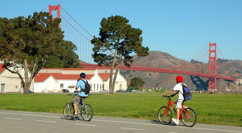 Cyclists in San Francisco near Golden Gate Bridge.