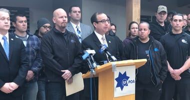 SF POA president Tony Montoya at the mic during the presser about the Jamaica Hampton case
