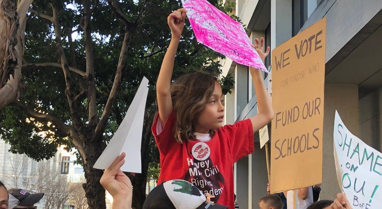 Students, teachers and parents gather to protest budget cuts to San Francisco public schools.