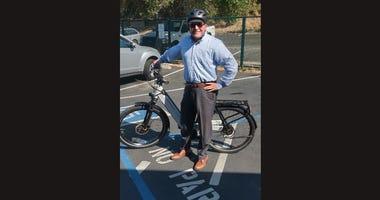 KCBS Radio reporter Jeffrey Schaub displays an electric bike in Marin County.