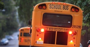 A school bus picks up students on October 10, 2008 in Pasadena, California.