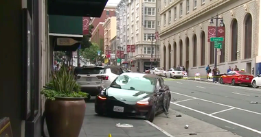 A pedestrian was killed and his wife critically injured after a Tesla sped through a red light in the Tenderloin neighborhood of San Francisco on July 21, 2019.
