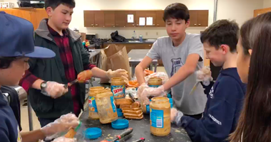 Students at Joaquin Moraga Intermediate School make sandwiches for homeless people through teacher Brett Lorie's 10,000 Lunches nonprofit.
