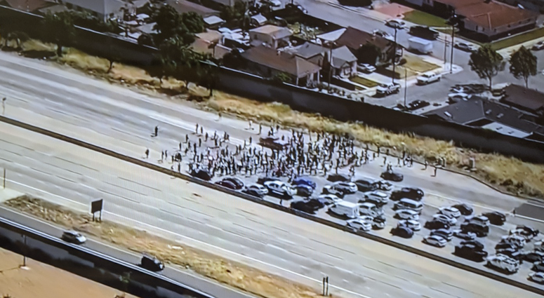Protesters block traffic on Highway 101 in San Jose.