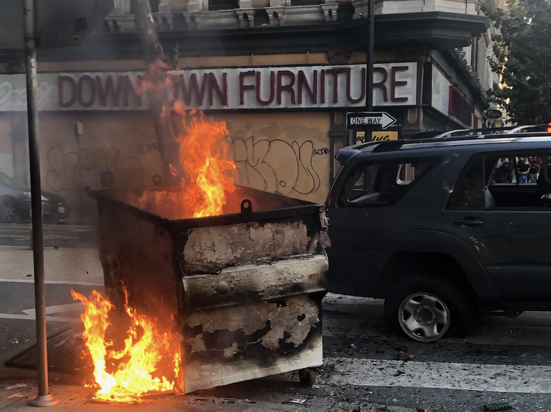A dumpster on fire in downtown San Jose during a protest over the death of George Floyd.
