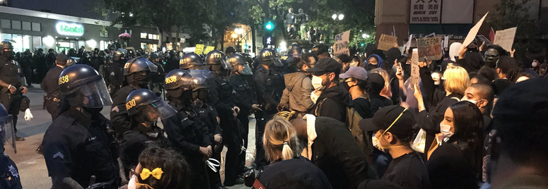 Protesters go toe-to-toe with officers in Oakland.
