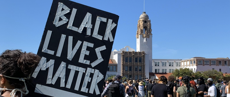 A protester holds a sign in San Francisco's Dolores Park during a Black Lives Matter protest.