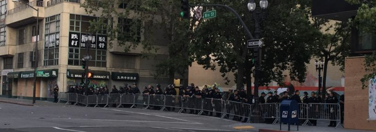 A line of officers in downtown Oakland on Wednesday night.