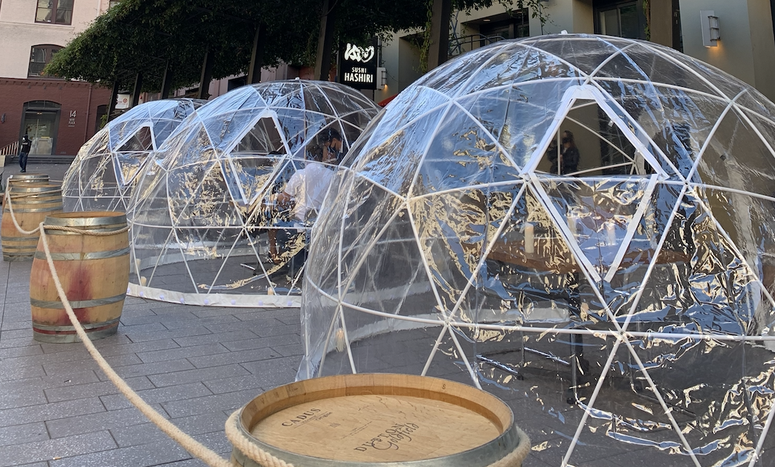 Igloo-like plastic dining bubbles line San Francisco's Mint Plaza outside sushi eatery Hashiri in early August.