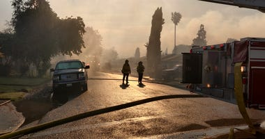 Smoke hangs over a neighborhood in Suisun City during a large marshland fire.