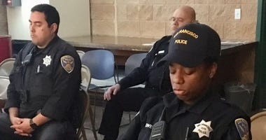 "San Francisco police officers practice ""tactical breathing"" in a class taught by a yoga instructor."
