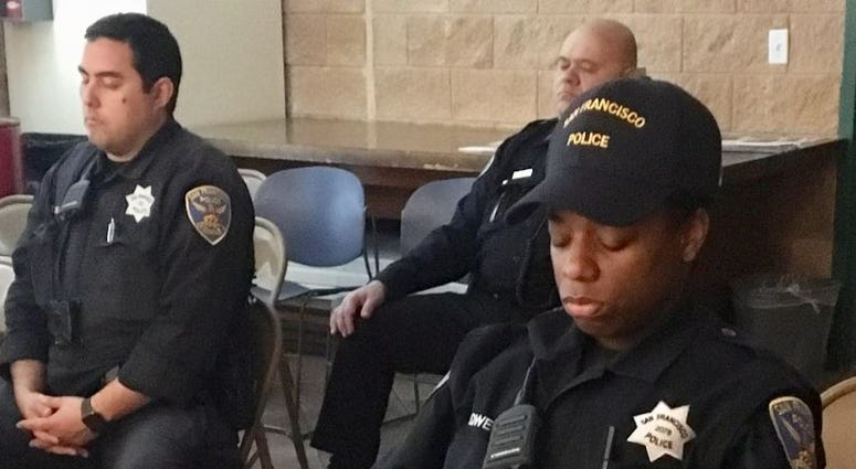 """San Francisco police officers practice """"tactical breathing"""" in a class taught by a yoga instructor."""