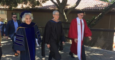 Apple CEO Tim Cook, center, spoke to students graduating from Stanford University on June 16, 2019.