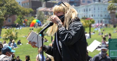 "A speaker addresses the crowd at San Francisco's ""Pride Is A Riot"" event Sunday in Dolores Park."