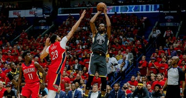 May 6, 2018; New Orleans, LA, USA; Golden State Warriors forward Kevin Durant (35) shoots over New Orleans Pelicans forward Anthony Davis (23) during the second quarter in game four of the second round of the 2018 NBA Playoffs at the Smoothie King Center.