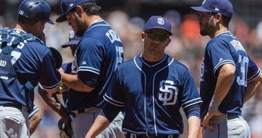 Jun 23, 2018; San Francisco, CA, USA; San Diego Padres manager Andy Green (14) returns from the mound after relieving starting pitcher Matt Strahm (not shown) in the game against the San Francisco Giants in the fourth inning at AT&T Park. Mandatory Credit