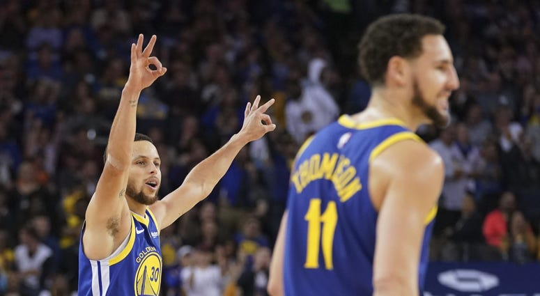 April 5, 2019; Oakland, CA, USA; Golden State Warriors guard Stephen Curry (30) and guard Klay Thompson (11) celebrate after a made three-point basket against the Cleveland Cavaliers during the second quarter at Oracle Arena.