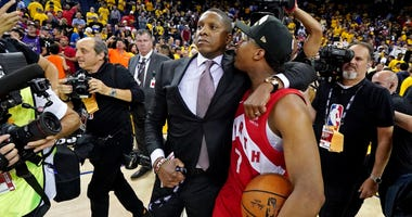 oronto Raptors president Masai Ujiri and guard Kyle Lowry (7) celebrate beating the Golden State Warriors in game six of the 2019 NBA Finals at Oracle Arena. Mandatory