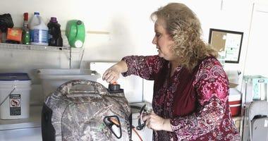 Anderson Vice Mayor Melissa Hunt fires up a generator to keep a friend's refrigerator-freezer running on Monday, Oct. 28, 2019,