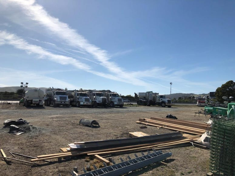 Construction trucks line the site of the Alemany Project on Highway 101 in San Francisco.