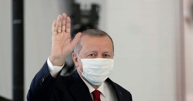 The Latest: Turkey opens 2 hospitals for virus patients