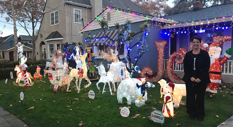 A San Jose neighborhood saves the day for Lynn Jimenez and her son Chris after their holiday yard display was hit by thieves.