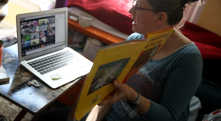 Leanne Francis, first grade teacher at Harvey Milk Civil Rights Academy, conducts an online class from her living room in San Francisco