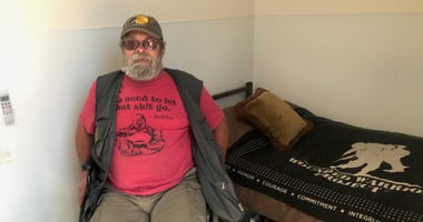 A homeless resident in his new, socially distanced shelter