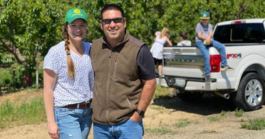 Jessica and Larry Enos, owners of 5 Star Cherries in Brentwood, CA, at their orchard.
