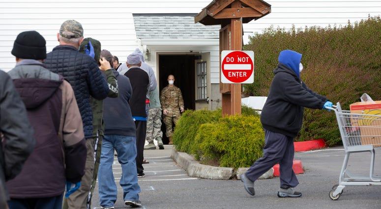 People wait in line outside Washington state food bank