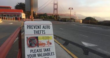 Anti-Auto Theft Warning Sign At Golden Gate Bridge