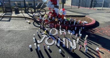 A memorial was created in Deer Valley High School's parking lot for a 16-year-old student who was fatally shot after a basketball game on Jan. 31, 2020.