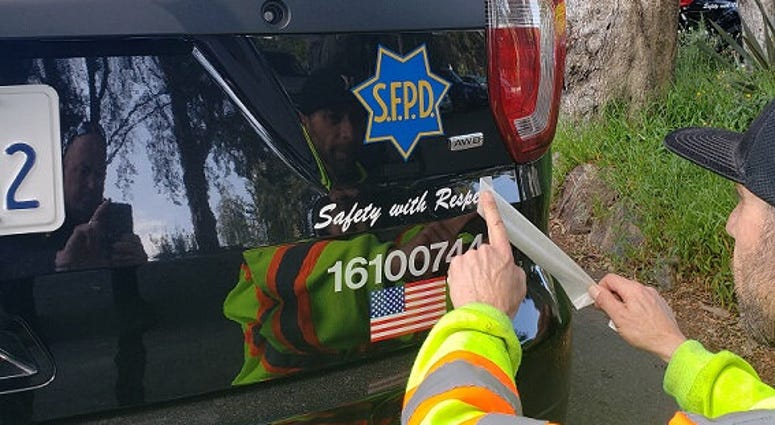 """The new motto of the San Francisco Police Department — """"Safety and Respect"""" — has been added to patrol cars."""