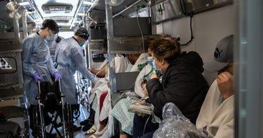 Medics transfer coronavirus patients to a NYC hospital