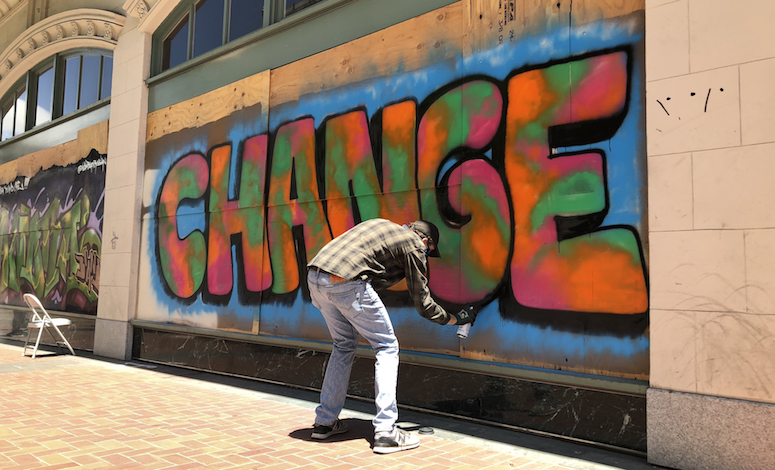 Oakland's art community is rushing to preserve dozens of pieces of protest art. Maxwell Shaver is seen here creating one of those murals.